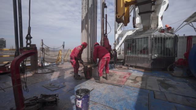 vídeos y material grabado en eventos de stock de china's beiken energy group gas drilling in ukraine's poltava region - operar