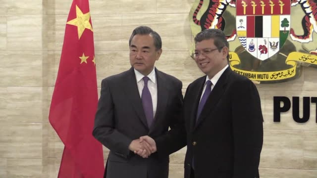 china's foreign minister wang yi meets his malaysian counterpart saifuddin abdullah in the administrative capital of putrajaya to discuss bilateral... - putrajaya stock videos & royalty-free footage