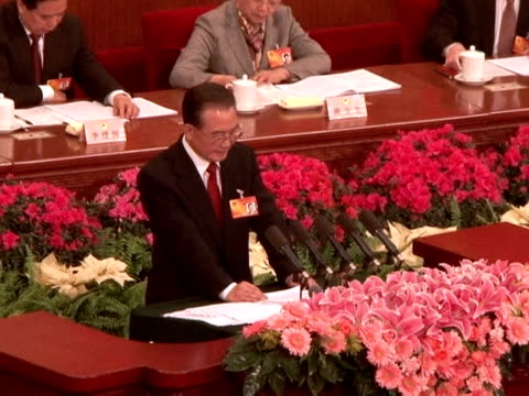 china's government on friday predicted another year of rapid expansion while vowing to tame inflation and curb runaway loan growth to forestall a... - tame stock videos and b-roll footage