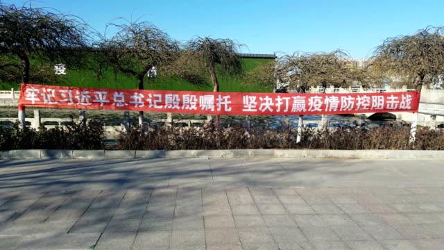 china's novel coronavirus (2019-ncov) pneumonia epidemic prevention slogan - execution stock videos & royalty-free footage