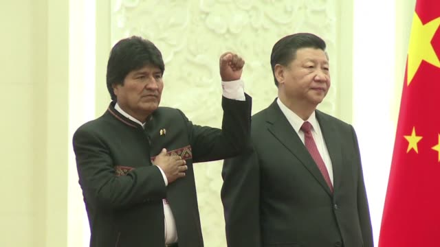 china's president xi jinping welcomes bolivia's president evo morales at the great hall of the people for the beginning of his official visit to china - evo morales stock videos & royalty-free footage