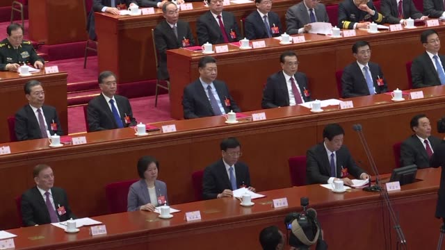 china's rubber stamp parliament approves a foreign investment law that promises to create a level playing field for both domestic and overseas... - kongressversammlung stock-videos und b-roll-filmmaterial