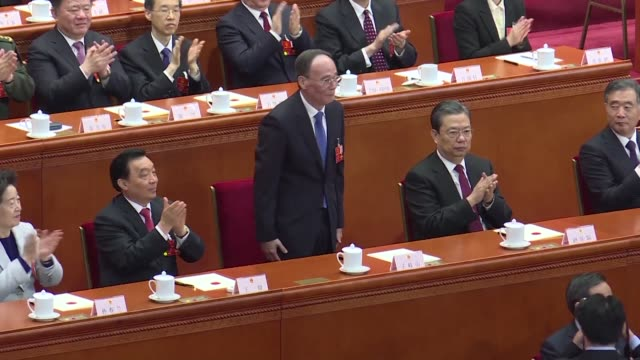 China's rubber stamp parliament unanimously handed President Xi Jinping a second term Saturday and elevated his right hand man to the vice presidency...