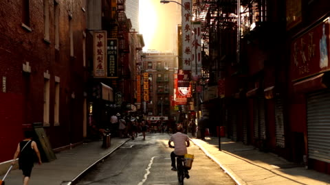 chinatown pell street sunset scene in new york city - chinatown stock videos & royalty-free footage