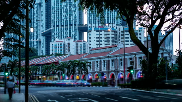 chinatown road with traffic in singapore time lapse. - full hd format stock videos & royalty-free footage