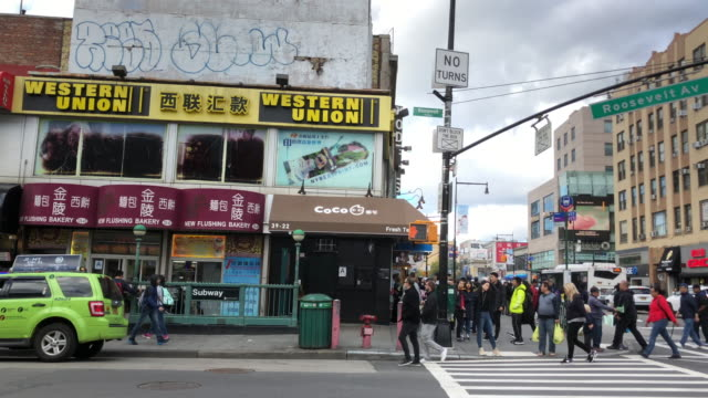chinatown traffic and intersection in flushing, ny - queens stock-videos und b-roll-filmmaterial
