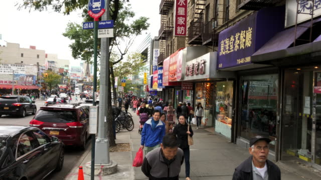 chinatown traffic and people shopping, walking, flushing, ny - the americas stock videos & royalty-free footage