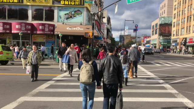 chinatown traffic and people shopping, walking, flushing, ny - queens new york city stock videos & royalty-free footage