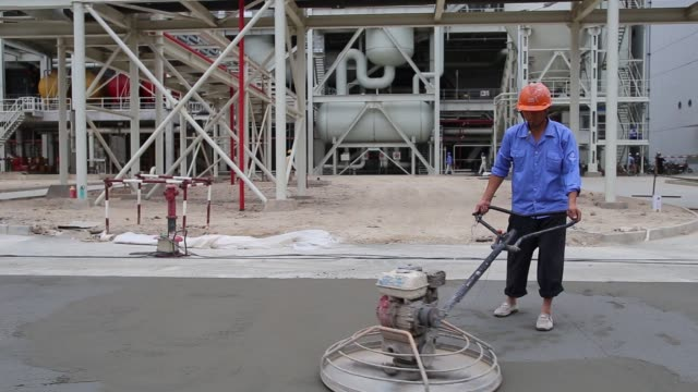 chinese and pakistani workers labor on the construction of a road beneath a banner bearing a safety message written in mandarin chinese script and... - pakistan stock videos & royalty-free footage
