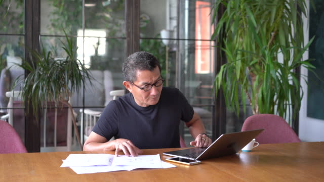 chinese architect working at home - confusion stock videos & royalty-free footage