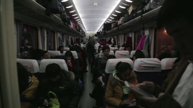 chinese authorities expect more than 28 billion trips to be taken over the festive chinese new year period creating huge demand for limited train... - fordern stock-videos und b-roll-filmmaterial