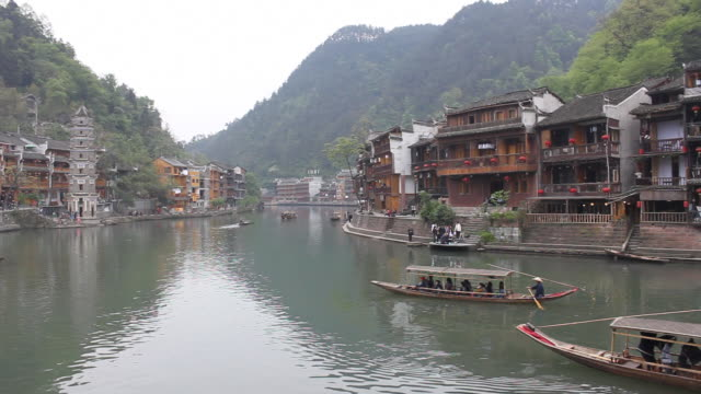 chinese boats rowing in a column - eaves stock videos and b-roll footage