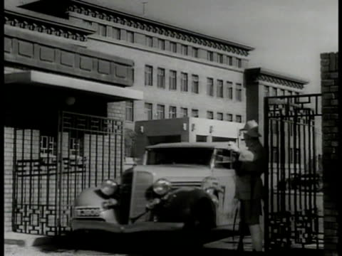 chinese building w/ fountain rickshaw ws car entering guarded gate ws government building ws chinese independence hall la ms clock tower of... - 1937 stock videos and b-roll footage