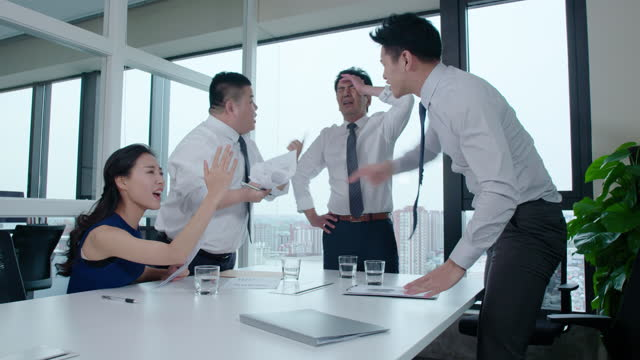 chinese business people arguing in meeting room,4k - office politics stock videos & royalty-free footage