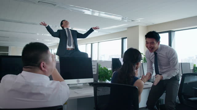 chinese business people clapping in office,4k - office politics stock videos & royalty-free footage