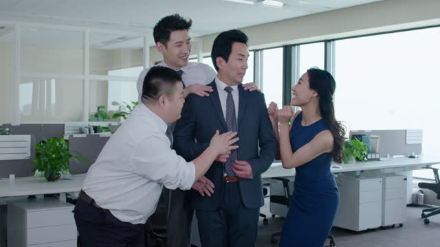 chinese business people flattering boss,4k - office politics stock videos & royalty-free footage