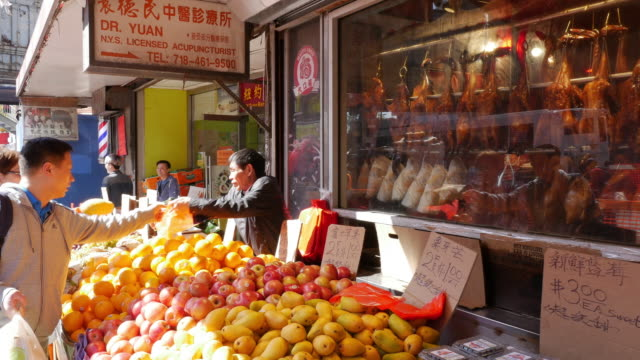 chinese buying fruits from street vendor in flushing, queens, new york - flushing queens stock videos and b-roll footage