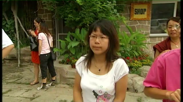 Chinese bystanders watching Vox pop unsympathetic Chinese people on hypocrisy of Westerners supporting Tibet campaign