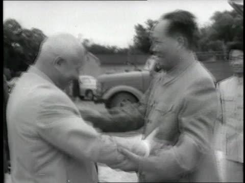 Chinese Chairman Mao Tse Tung and Soviet Premier Nikita Khrushchev hug and shake hands
