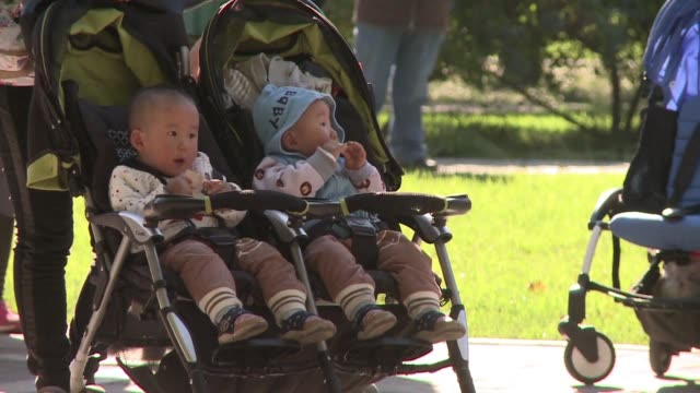 chinese citizens greet the announcement of a two-child policy warily as high costs career aspirations and rising urbanisation in an increasingly... - strategy stock videos & royalty-free footage