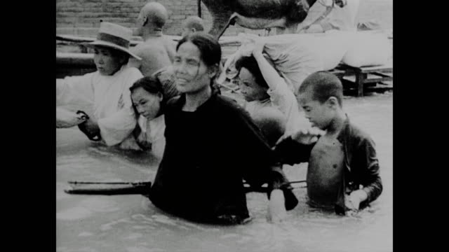 WWII Chinese civilians blow up the southern dyke at Chengchow railway junction flooding the Yellow River drowning invading Japanese soldiers and...