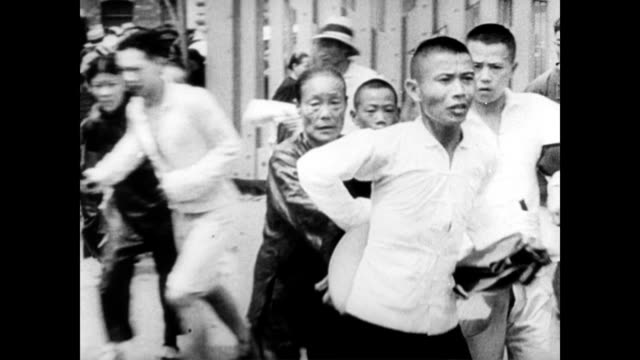 / chinese civilians screaming and running through the streets / building destroyed by bomb explosion / aerial of chinese civilians running / chaos,... - bomb stock videos & royalty-free footage