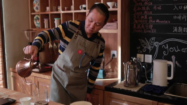 chinese coffee shop owner making coffee - cafeteria worker stock videos and b-roll footage