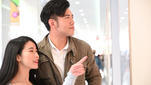 chinese couple window shopping in mall - mid adult couple stock videos & royalty-free footage
