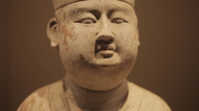 a chinese cultural relic stands on display at the museum of qin in xi'an, china. - craft stock videos & royalty-free footage