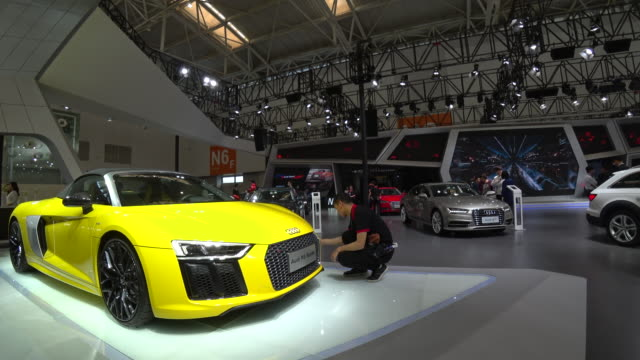 chinese customers on the audi exhibition booth on april 28th the seventh china international automobile industry exhibition was held in meijiang... - the center stock videos and b-roll footage