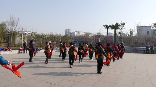 chinese dama are dancing waist drum in a park square on a morning according to a report on china's square dancing industry released in 2015 it is... - waist stock videos & royalty-free footage