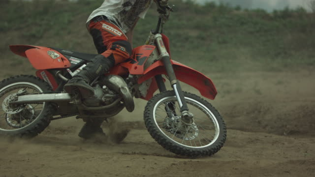 Chinese dirt bike racer jumping and spinning in Beijing