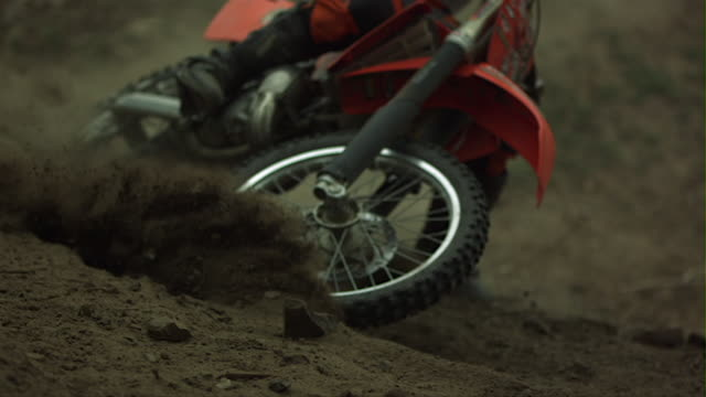 chinese dirt bike racer jumping and spinning in beijing - schlamm stock-videos und b-roll-filmmaterial