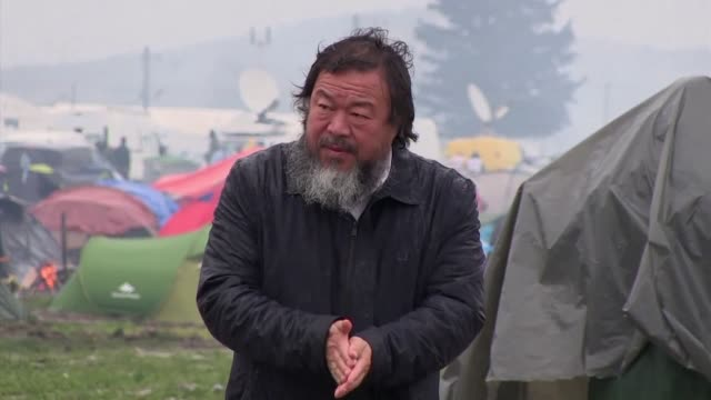 Chinese dissident artist Ai Weiwei organizes a piano performance on the Greek Macedonian border where some 12000 refugees and migrants stuck in grim...