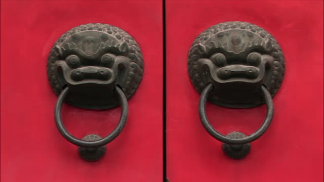 zi, cu chinese door knockers - pair stock videos & royalty-free footage