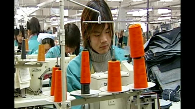chinese economy booming; beijing: int chinese people working at sewing machine in levi's clothes factory - levi's stock videos & royalty-free footage