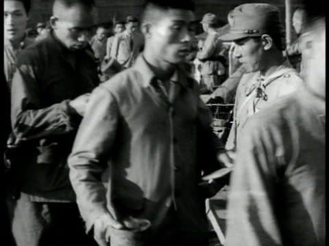 chinese factory workers passing japanese guard ms 'armstrong linoleum' store ms workers into factory gates ws carrying oil drums 'texaco' tank bg... - ドラム容器点の映像素材/bロール
