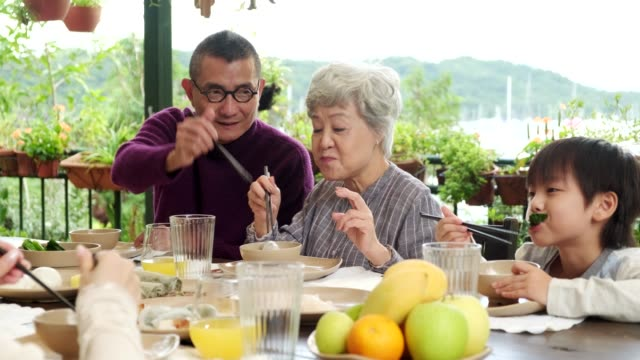 chinese family eating outdoors - togetherness stock videos & royalty-free footage