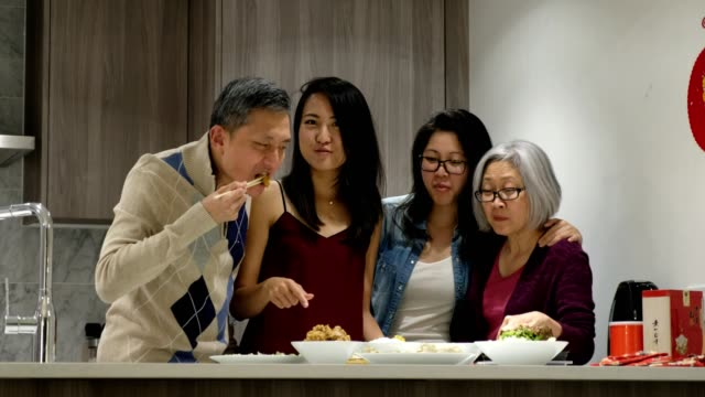 chinese family enjoying meal time - chinese ethnicity stock videos & royalty-free footage