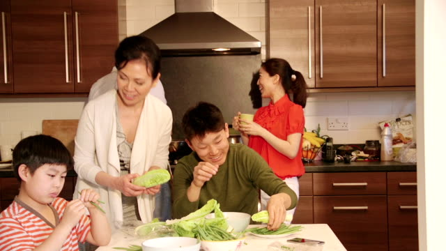 chinese family having fun making food! - evening meal stock videos and b-roll footage