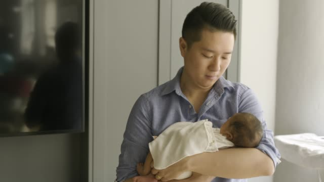 chinese father holding newborn baby. - genderblend stock videos & royalty-free footage