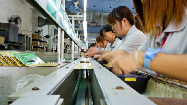 chinese female workers producing pcbs china time lapse - officina video stock e b–roll