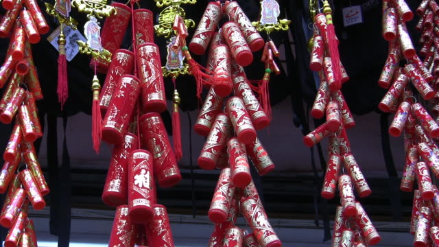 CU, Chinese fire crackers  hanging on street market in Chinatown, New York City, New York, USA,