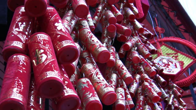 cu, la, chinese fire crackers  hanging on street market in chinatown, new york city, new york, usa, - chinese language stock videos & royalty-free footage