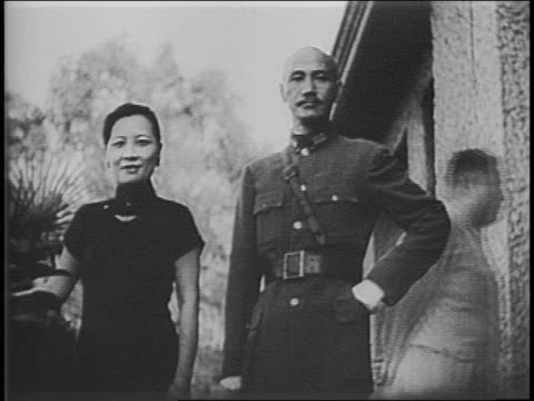 chinese first lady madame chiang disembarks train in washington dc / chiang receives bouquet of flowers / eleanor roosevelt and chiang walk out of... - chiang kai shek stock-videos und b-roll-filmmaterial