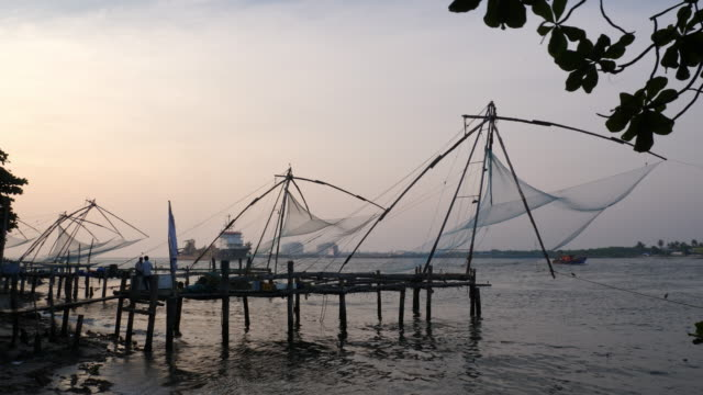 chinese fishing nets at sunset, kochi / india - fishing stock videos & royalty-free footage