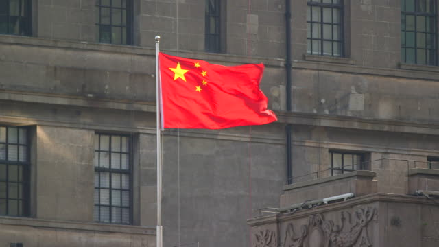 chinese flag blowing in the wind - shanghai, china - chinese flag stock videos and b-roll footage