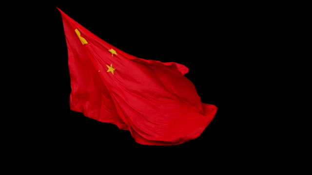 chinese flag isolated on black - chinese flag stock videos and b-roll footage