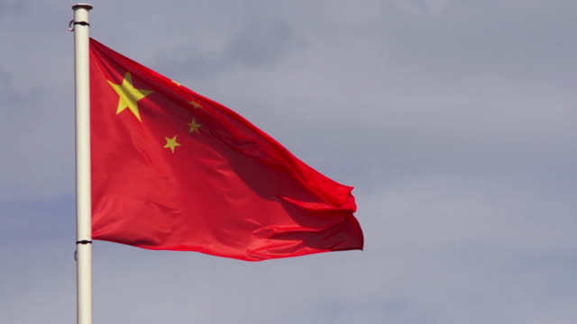 chinese flag. slow motion. - chinese flag stock videos & royalty-free footage