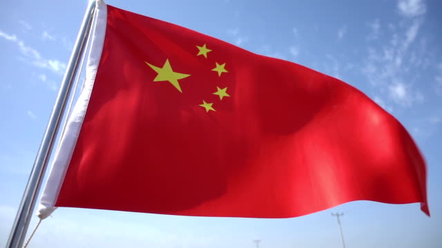 chinese flag - flag blowing in the wind stock videos & royalty-free footage